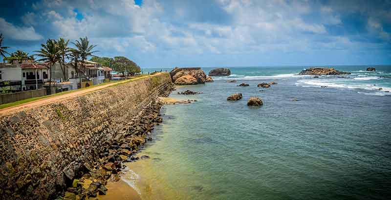 Southern Province Honeymoon Destinations - Rocky beach in font of Galle Fort